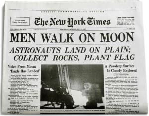 man walks on moon newspaper